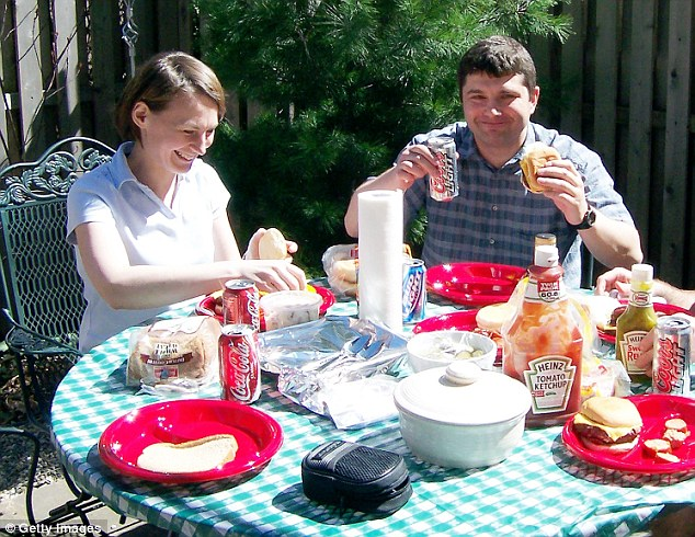 Co-accused: Two of the other alleged Russian spies, Cynthia and Richard Murphy, enjoying an all-American cookout in an undated image from the period when they were living in Hoboken, New Jersey