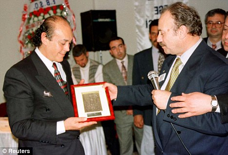 Lauded: Nadir, who has prospered in exile, receives a business award in 1994