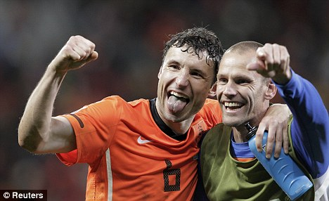 Last laugh: Van Bommel celebrates after securing his side's place in the final
