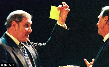 Yellow peril: Taylor jokingly books Dutch legend Johan Cruyff during the FIFA 1998 Player of the Year awards