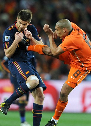 Missed: Nigel de Jong escaped with just a yellow card for this kick on Xabi Alonso. Webb was poorly positioned at the time