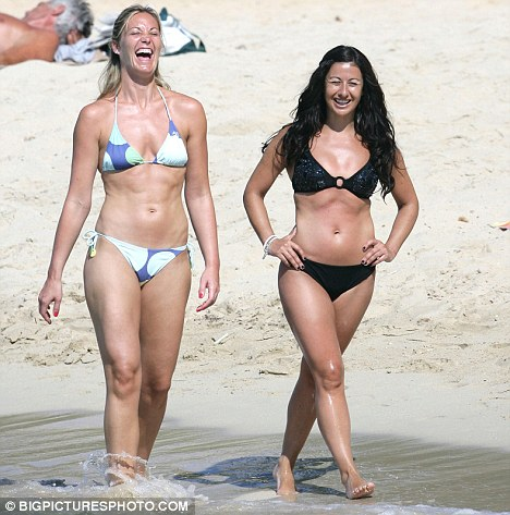 Looking happy: Hayley Tamaddon relaxes on the beach in Spain with a friend following her split from Darren Charles