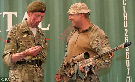 Surprise: The Duke of Kent with Lance Sergeant Moreton during his visit to the 1st Battalion, The Scots Guards Battlegroup