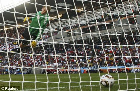 Germany keeper Manuel Neuer watches as Frank Lampard's shot lands behind the line in South Africa, but the goal wasn't given