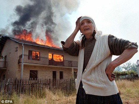 Ethnic conflict: An elderly Kosovar weeps as she is driven from her home in 1999