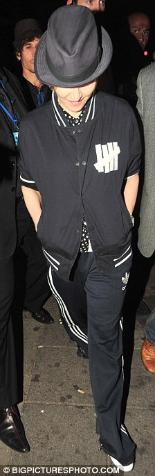 Rollin' with the homies: Madonna stepped out in a navy Adidas tracksuit as she threw a surprise party for her entourage in London at the weekend