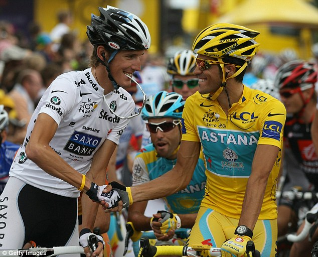 Congratulations: Andy Schleck offers his hand to Alberto Contador at the start of the final stage