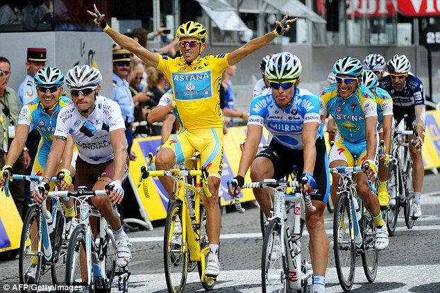 Savouring the moment: Alberto Contador celebrates as he crosses the finish line in Paris