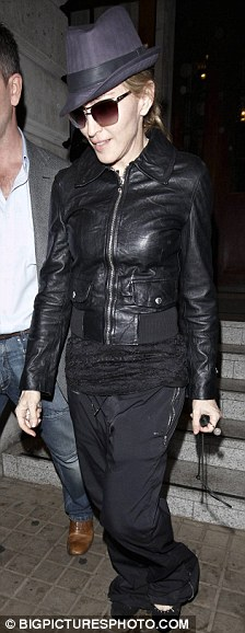 Casual: The 51-year-old teamed the black jogging bottoms with a black leather jacket, her favourite trilby hat and a pair of black pumps