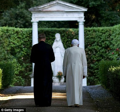 The Pope takes a stroll with his personal assistant Georg Genswein