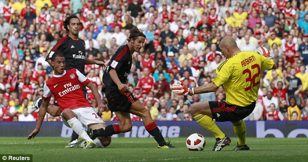 Cool customer: Marouane Chamakh (left) shakes off the attentions of Luca Antonini to beat keeper Christian Abbiati