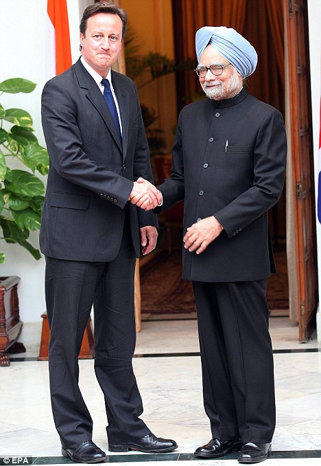 Humble: David Cameron with Indian Prime Minister Manmohan Singh in New Delhi