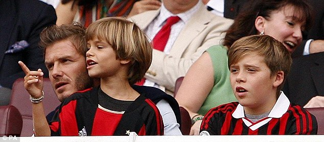 Family day out: David Beckham and sons Romeo and Brooklyn enjoy the Emirates