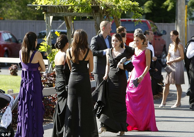 Glittering: Guests wait for a bus to depart from the Delamater Inn to go to the wedding