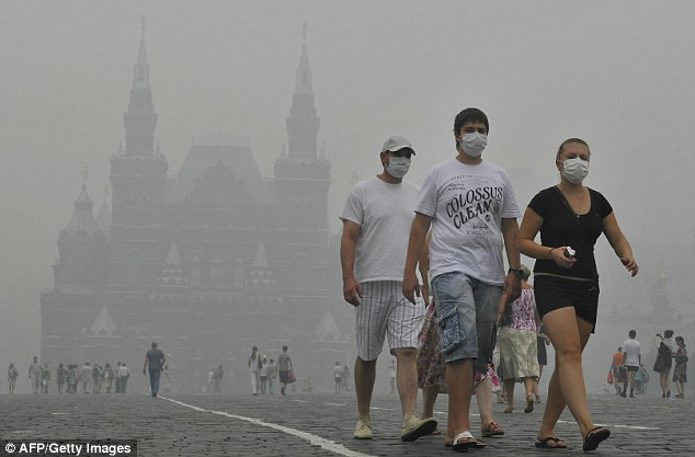 Russia wildfiresChoking: Russians walking in Red Square wearing facemasks. Authorities have questioned whether the 10,000 firefighters tackling the blaze is enough to put them out
