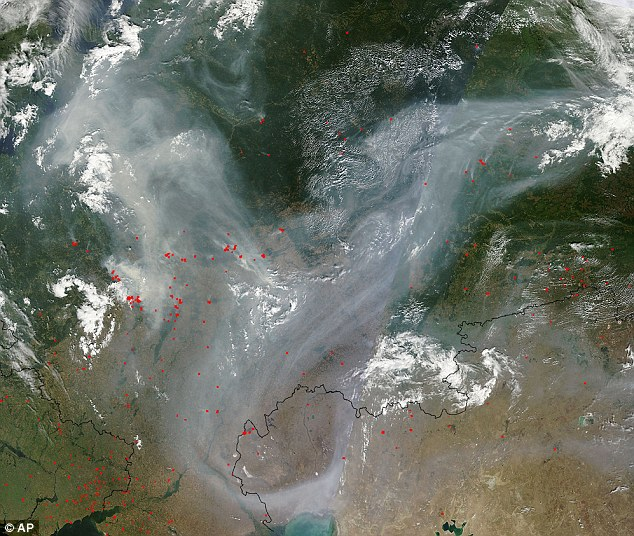 Capacity: This Nasa satellite image shows the full extent of more than 500 fires tears through the Russian countryside