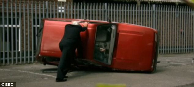 Stunt: A Reliant Robin is righted by a Top Gear guest after presenter Jeremy Clarkson deliberately 'capsized' the car