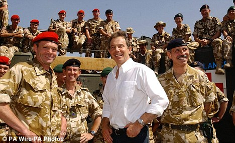 The decent thing: Former Prime Minister Tony Blair, pictured meeting the troops in Iraq in 2003, is donating the profits from his memoirs to a new sports centre for injured troops