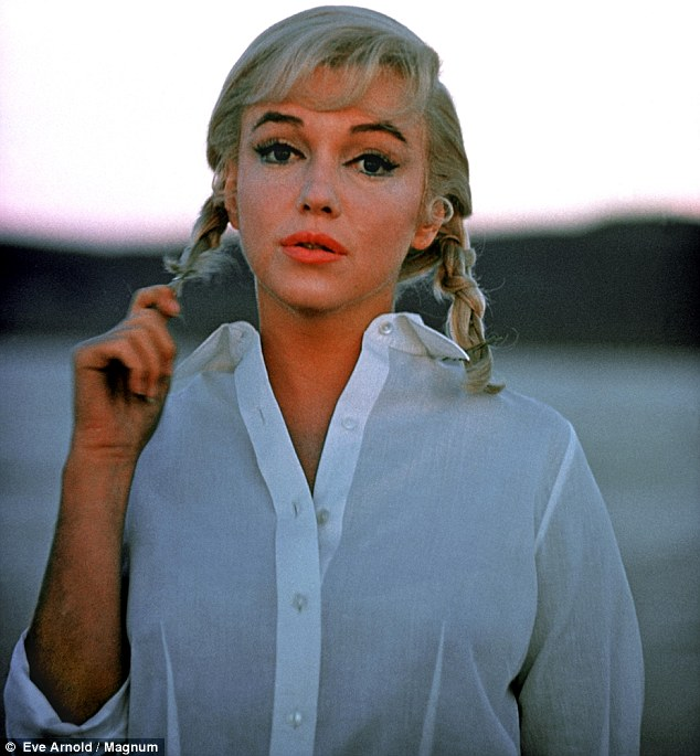 Candid portrait: A sombre-faced Marilyn Monroe, appears a far cry from Hollywood glamour as she is shot on set of The Misfits in Nevada in 1960,  in a series of intimate images captured by photo-journalist Eve Arnold