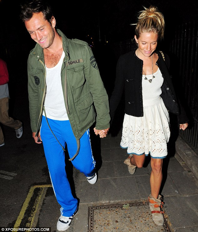 Smiley, happy people: Jude and Sienna couldn't keep the smiles off their faces as they enjoyed an evening stroll