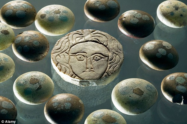 Treasures: Decorated glass gaming counters found at the second century site. Pertinax is believed to have fled the villa after soldiers mutinied