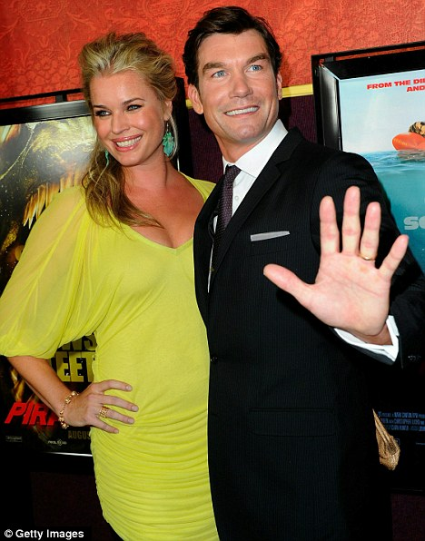 Give us a wave: Kelly's Piranha co-star Jerry O'Connell smiles broadly for the cameras as he and actress wife Rebecca Romijn arrive at the premiere