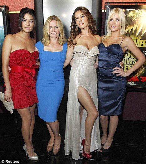 Time to shine: Kelly certainly made sure she was the centre of attention as she posed with co-stars Jessica Szohr, Elisabeth Shue and Riley Steele