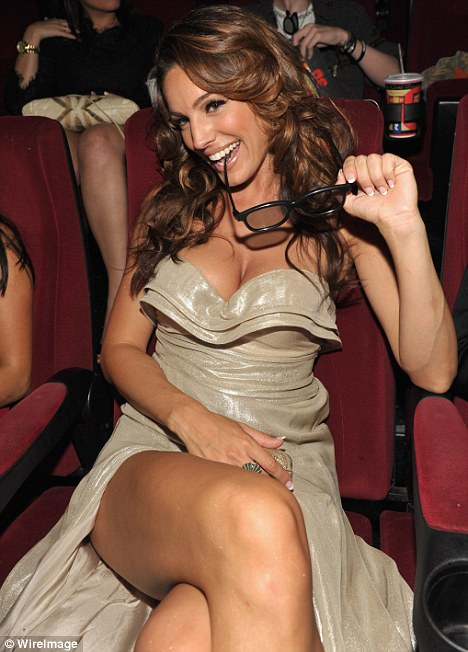 Glittering: Kelly Brook settles down to enjoy the premiere of Piranha 3D in Los Angeles