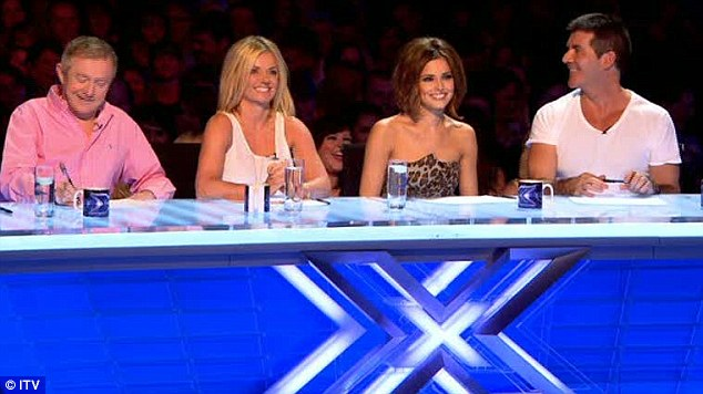 New line-up: Judges (left to right) Louis Walsh, Cheryl Cole and Simon Cowell with Geri Halliwell, who was standing in for Dannii Minogue, watch as Gamu performs
