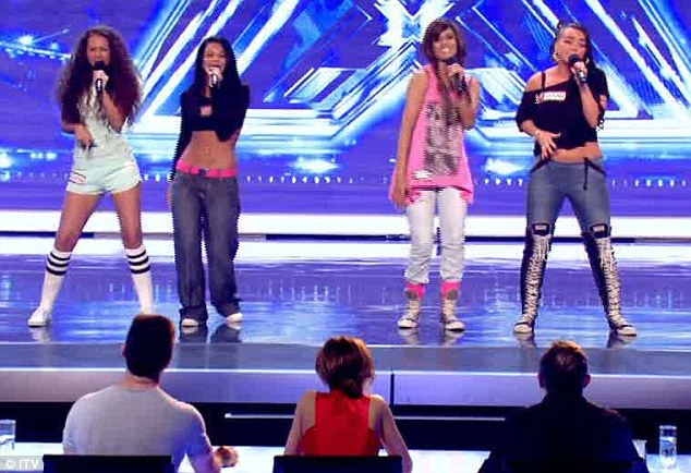 Dice: The tummy-baring girlband Dice went down well with the judges, but Cheryl Cole told them to ease up on the fake tan