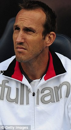 Safe pair of hands: Mark Schwarzer is still a Fulham player and Mark Hughes wants it to remain that way