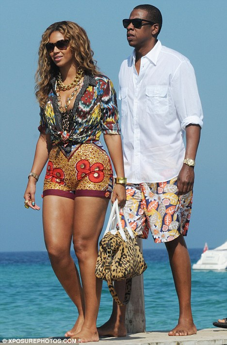 Colourful pair: Beyonce's husband Jay-Z also opted for a colourful pair of shorts, which he teamed with a plain white shirt