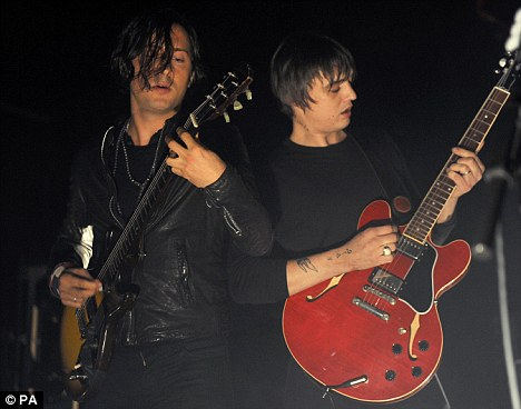 Back together: Pete Doherty (right) and Carl Barat perform together for the first time in six years