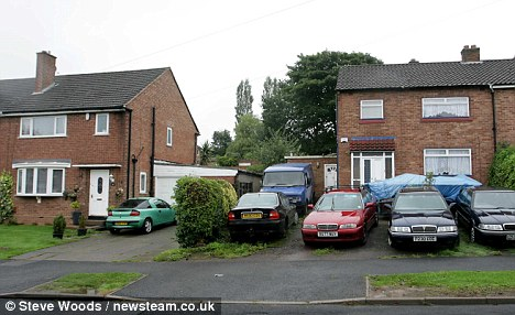 Nuisance neighbours: Andrew Nicklin, who admitted harrassing Caroline Farrell over her barking terrier, lives at the house on the right