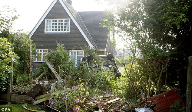 Narrow escape: Luckily no-one was seriously hurt and the house avoided any structural damage