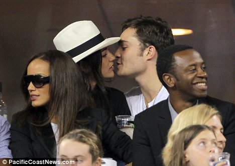 Ed Westwick and Jessica Szohr give the crowd plenty to gossip about as they are spotted kissing and quaffing at the US Open.