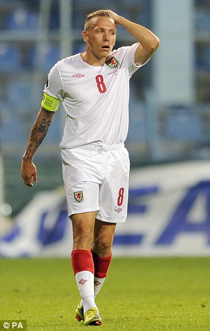 Anguish: Craig Bellamy reacts to Mirko Vucinic's goal