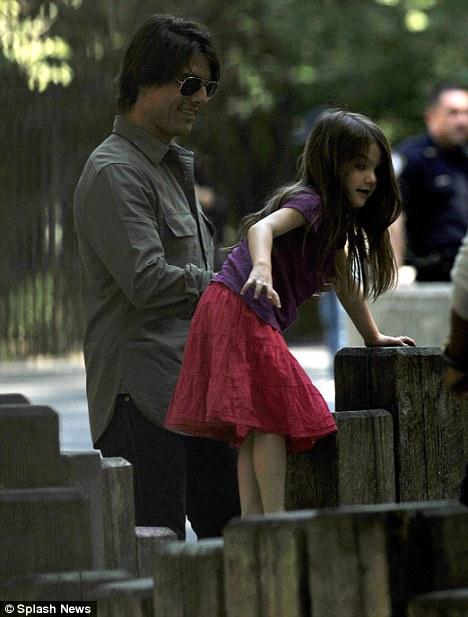 Pretty at the playground: Cruise helps Suri as she has fun on the climbing frame