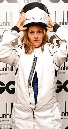 It's me! Emin arrived at the event as the Stig before unveiling herself