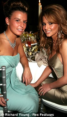 Support: Coleen Rooney has received texts from her friend Cheryl Cole, seen with her in 2006