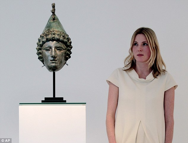 Under the hammer: Georgiana Aitken, the Head of Antiquities at  Christie's London, poses for photographs with the helmet