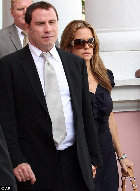 John Travolta and wife Kelly Preston leave the court building in Nassau, Bahamas, in September 2009, during the extortion trial