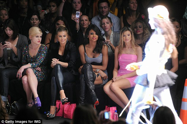 Fashion fans: Kelly, who walked in the show last year, watched from the front row with actress Carmen Electra