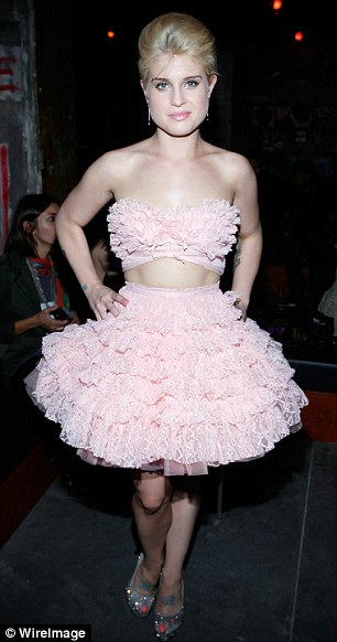 Model size: Newly slim Kelly Osbourne tries on one of the sample-sized dresses at the Betsey Johnson show