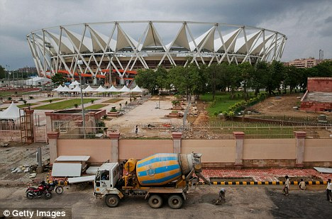 What a shambles: Nehru Stadium resembled a building site as workers carried out emergency repairs