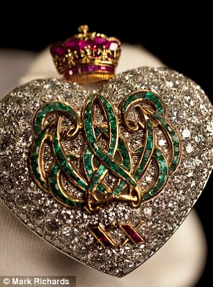 Love story: Many of the pieces, like this emerald, ruby and diamond brooch are by Cartier and document what has become know as one of the greatest love stories of all time