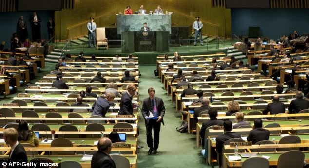 Diplomats from the the Swedish delegation walk out as Iranian President Mahmoud Ahmadinejad (background) addresses the  General Assembly