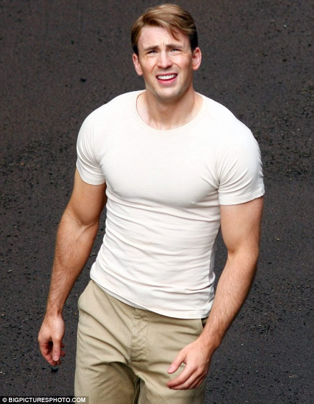 Muscle man: Evans has clearly bulked up for the new superhero film, in which he plays the title character