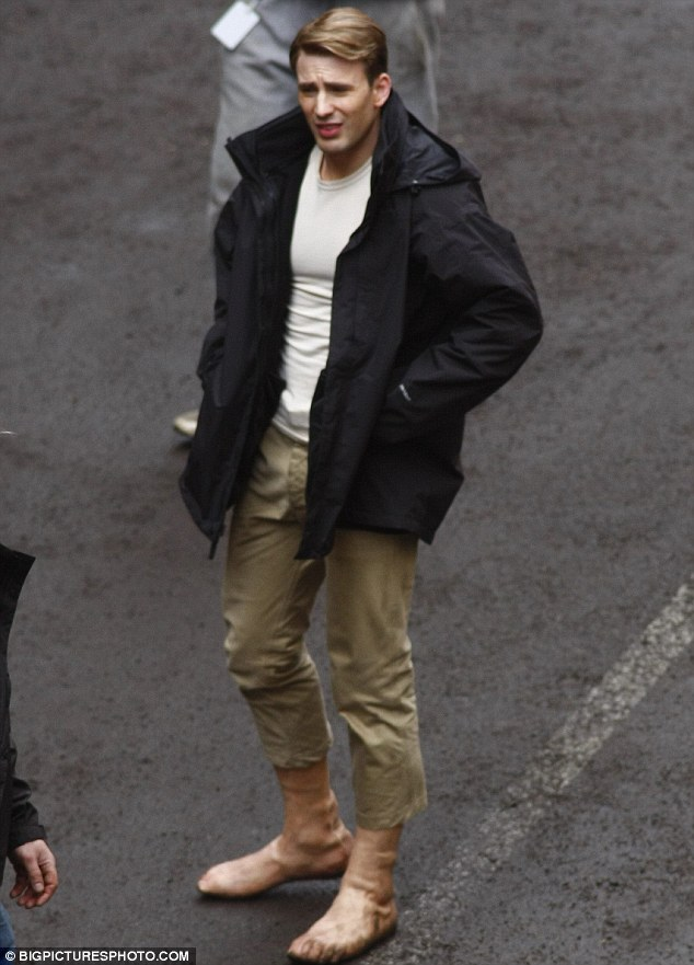 Safety comes first: Chris Evans was seen on the Captain America set in Manchester today wearing prosthetic feet ahead of a scene which saw him run barefoot down the cobbled streets
