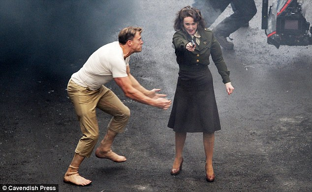 Ready...set... go! Evans's stunt double gears up for what looks like a painful scene where he has to wrestle a female stuntwoman to the ground
